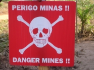 A sign warning about land mine dangers